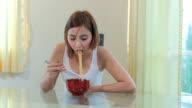 Young girl eating ramen noodles