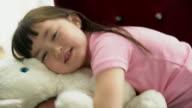 CU young girl hugging a teddy bear