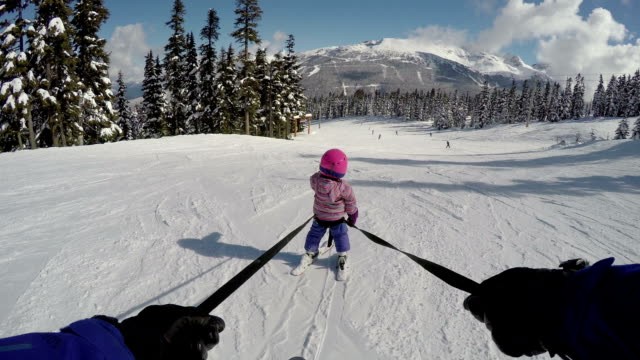 Young girl learning to ski