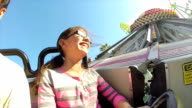 Young Girl on Spinning Fair Ride in Slow Motion