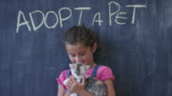 Young Girl Pets Newly Adopted Kitten