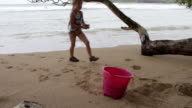 MS Young girl playing on beach / Kauai, Hawaii, United States