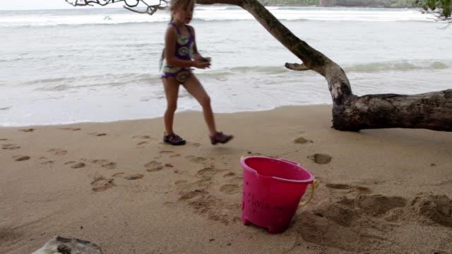 MS Young girl playing on beach / Kauai, Hawaii, United States