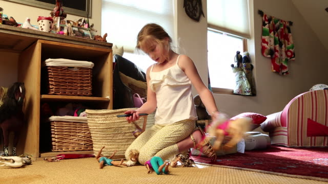MS TU Young girl playing with her dolls / Lamy, New Mexico, United States