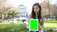 Young girl showing green screen tablet