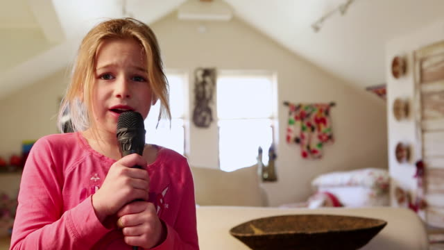MS Young girl singing Karoke with dancing / Lamy, New Mexico, United States