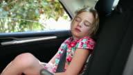 MS Young girl sleeping in car / St. Simon's Island, Georgia, United States
