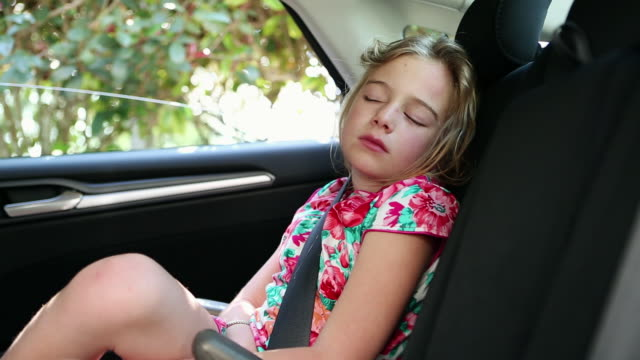 MS Young girl sleeping in car / St. Simon's Island, Georgia, United States