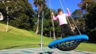 Young girl swinging on a swing