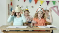 young girls in classroom - wearing funny animal masks