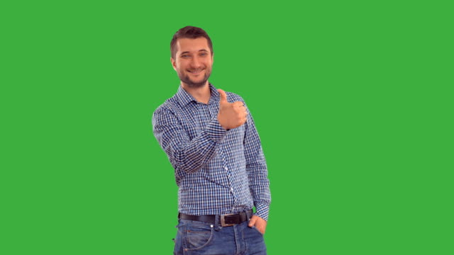 Young guy showing ban on a green background