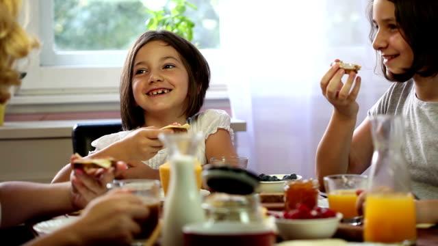 Young Happy Family Having Breakfast