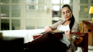Young hipster woman with guitar