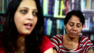 Young Indian woman in argument with Senior Lady