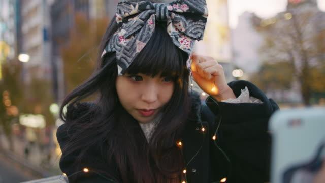 A young Japanese woman in Harajuku / Tokyo, Japan