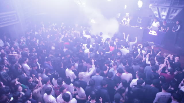 HA, WS Young Koreans party on the dancefloor at a trendy nightclub in central Seoul / Seoul, South Korea