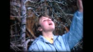 1968 young lady dramatically sings near Swiss Chateau