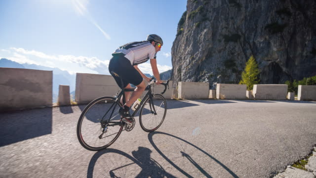 Young male athlete cycling on a mountain pass
