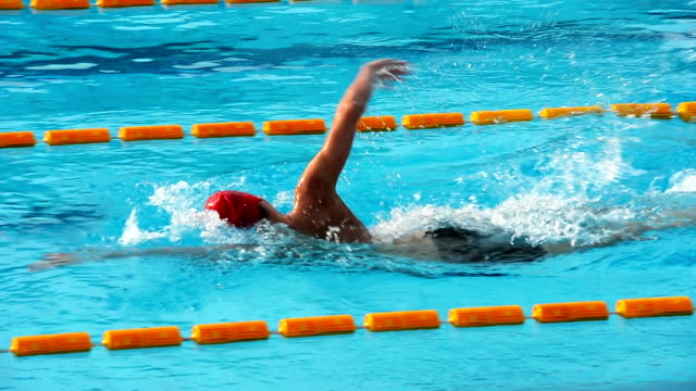 HD: Young male swimmer at Front crawl