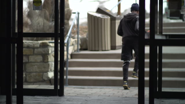 A young man basketball player leaving hotel to go practice.  - Slow Motion
