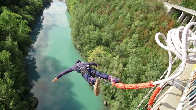 Young man bungee jumping