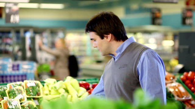 Young man buying vegetable