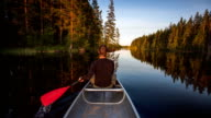 Young Man Canoeing in the Wilderness