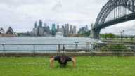 Young man doing push up exercise in the park.