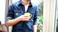 CU TU Young man drinking coffee