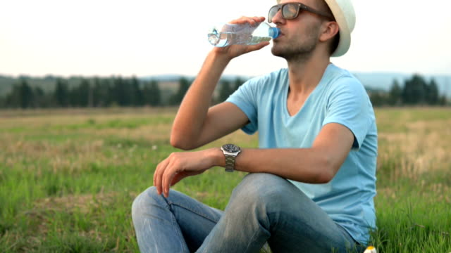Young man drinking water outdoor