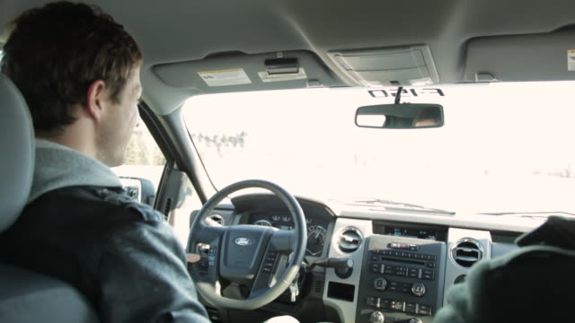 MS Young man driving truck and laughing / Stillwater, Minnesota, United States