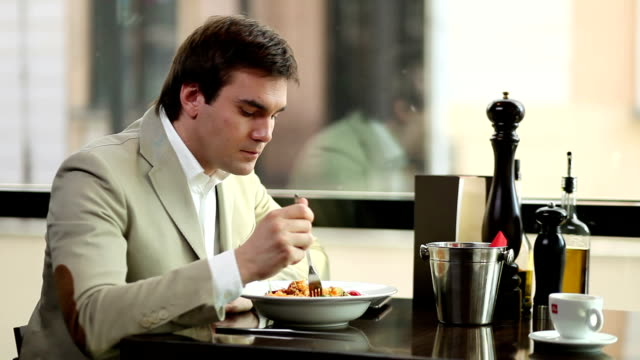 Young man eating in a restaurant.