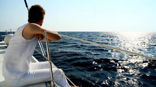 HD: Young Man Enjoying The Sailing