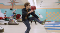 WS Young man falling down while Throwing bowling ball