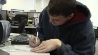 CU, Young man filling out form at Michigan Works office, Livonia, Michigan, USA
