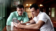 Young man friends in cafe using digital tablet