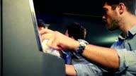 Young man gambling on slot machines