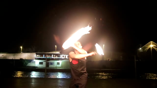 young man have performance with fire ball
