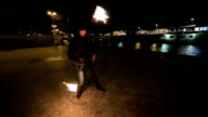 young man have performance with flame,camera stabilization shoot