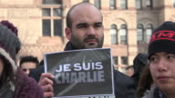 Young man holding sign reading 'Je Suis Charlie' at Nathan Phillips Square The multicultural people of Toronto protest against terrorism despite the...