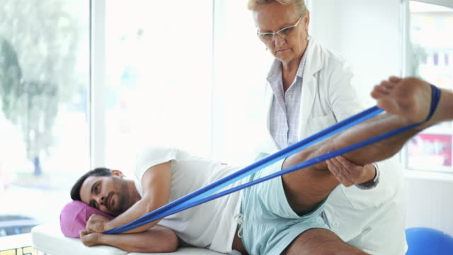 Young man in physical therapy.
