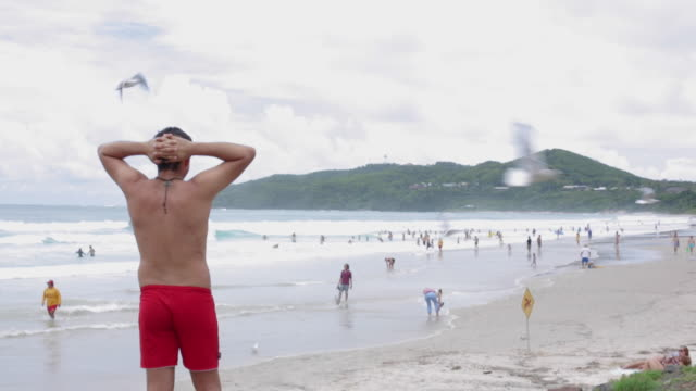 A young man is looking the amazing views and landscape of Byron Bay