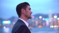 MS young man looking at the Hong Kong cityscape