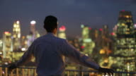 MS Young man looking at the view of the city at night.
