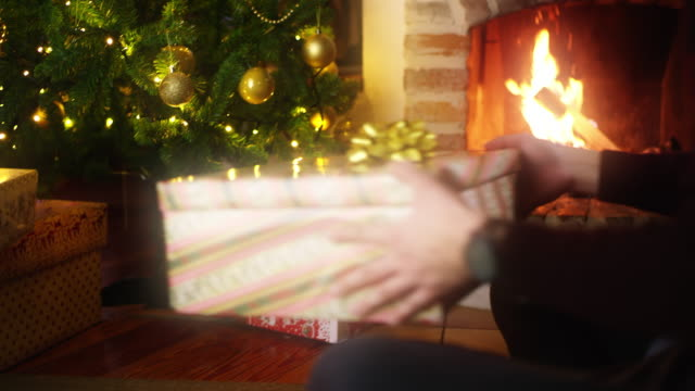DS MS Young man opening a Christmas present