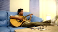 Young man playing guitar relax after time out
