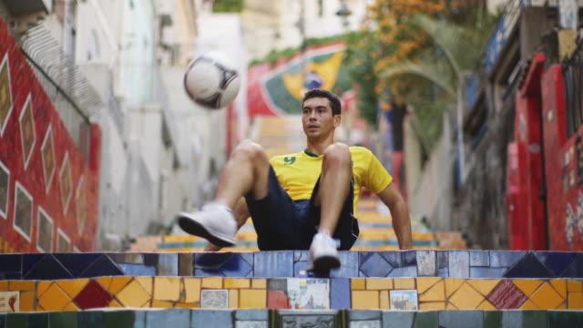 MS A young man practices football skills on Selaron Steps (Escadaria Selaron) / Rio de Janeiro, Brazil