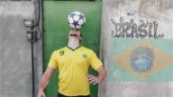 'MS A young man practices his football skills in a favela / Rio de Janeiro, Brazil'