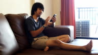Young man relaxing using cell phone