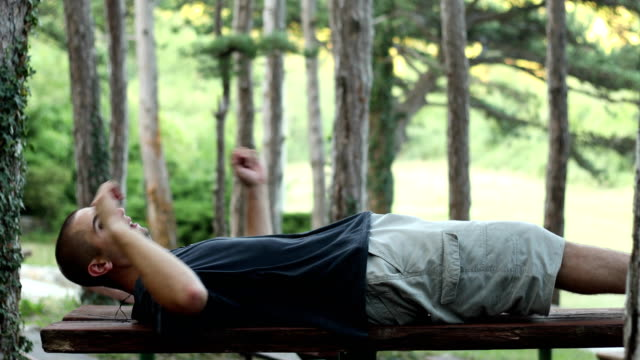 Young man resting on bench